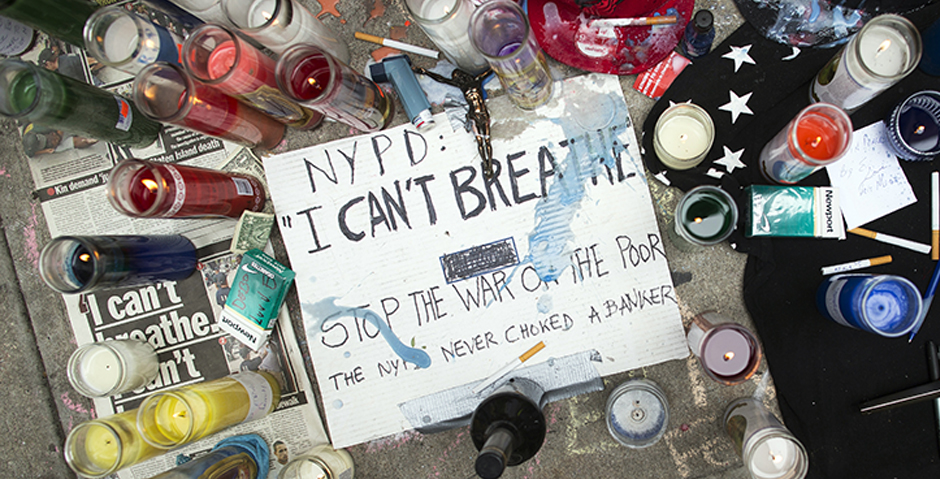 A memorial for Eric Garner rests on the pavement near the site of his death, Saturday, July 19, 2014, in the Staten Island borough of New York. The wife of a man who died after a police officer used an apparent chokehold to bring him to the ground during an arrest burst into tears Saturday at a Harlem rally in his honor. Eric was confronted by police trying to arrest him on suspicion of selling untaxed, loose cigarettes on a Staten Island sidewalk, authorities said. (AP Photo/John Minchillo)
